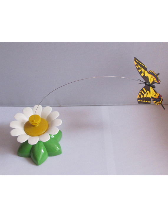 Rotating Butterfly, Accent your room with this Flying Butterly with Batteries(not included). Product size: 3.25 x 2.5 x3.25